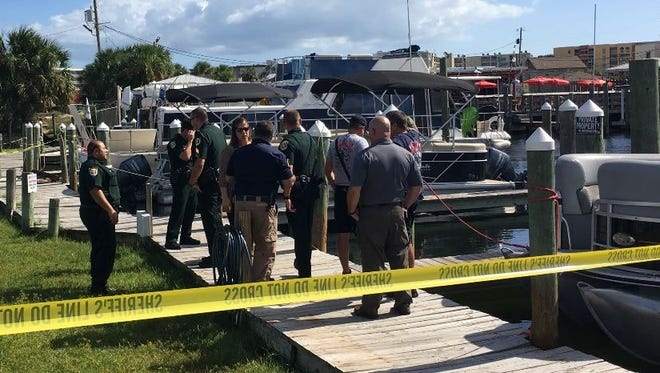 The Okaloosa County Sheriff's Office investigates after a man's body was found Wednesday, Oct. 4, 2017, by a boat slip on the Santa Rosa Sound.