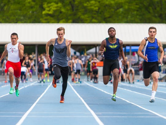 Snow Canyon's Tae Washington (right) races at the 4A state track championships in 2017.
