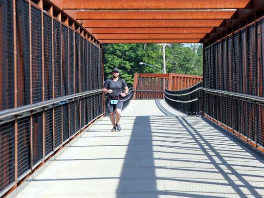 Marathoner Allen Clayton crosses a bridge on the Rail Trail near the 10 mile marker during the Walkway Marathon June 11, 2017 in Poughkeepsie.