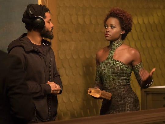 """""""Black Panther"""" director Ryan Coogler, left, on set"""