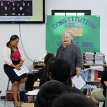 Senior Law Clerk Ranessa Santos-Packard and Associate Justice Katherine A. Maraman talk to students at Jose Rios Middle School as part of the Judiciary of Guam's Constitution Day outreach efforts.