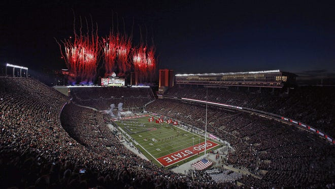The Ohio State Buckeyes take the field as fireworks go off at Ohio Stadium before the game against the Michigan State Spartans in Columbus on Oct. 5, 2019.