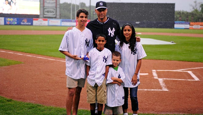Derek Jeter poses with kids as he is given the key to the City of Tampa, Fla., on Saturday.