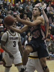 Tulare Western's Ira Porchia gets a layup against Tulare Union on Thursday in an East Yosemite League game at Tulare Union.