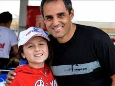 Juan Pablo Montoya with one of his racing pupils, 10-year-old Valeria Vargas.