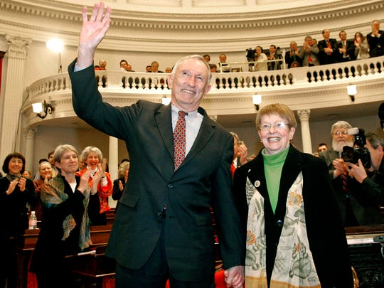 """Jim Jeffords waves to members of the Legislature at the Statehouse in Montpelier in January 2006, with his wife, Elizabeth """"Liz"""" Daley Jeffords."""