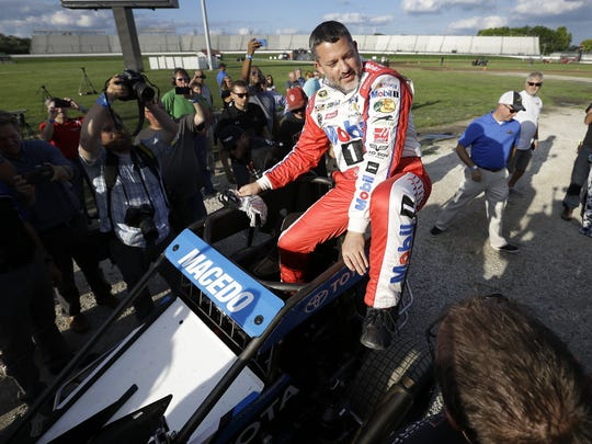 Tony Stewart climbs into Carson Macedo's midget race car to do a couple of laps on the three-sixteenths of a mile oval made for him inside turn three of   Indianapolis Motor Speedway.