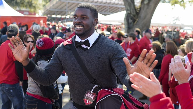 Jalen Nixon, now UL's No. 2 quarterback, greets fans during the Cajun Walk prior to the UL 2014 Homecoming football game.