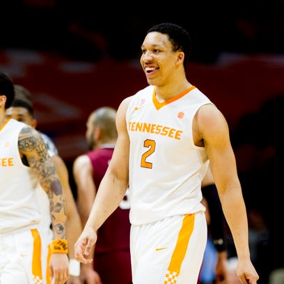 Tennessee forward Grant Williams (2) smiles in celebration