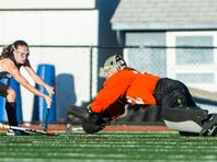 Cheyenne Sprecher, Palmyra, dives to stop Unionville's Morgan Lyons as Palmyra defeated Unionville 2-1 in the quarterfinals of the PIAA Class 3A tournament on Saturday, November 12, 2016.