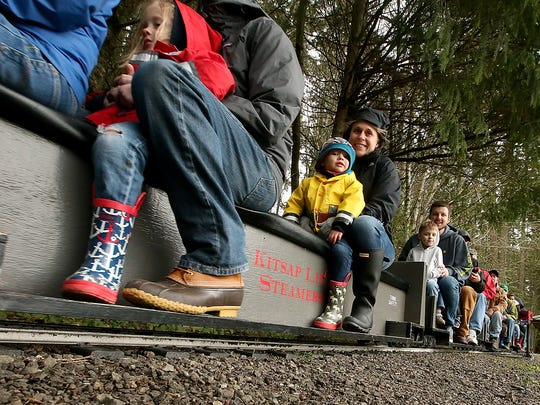 Passengers travel along the rails through South Kitsap Regional Park on a Kitsap Live Steamers Train in Port Orchard on Saturday, April 8, 2017.