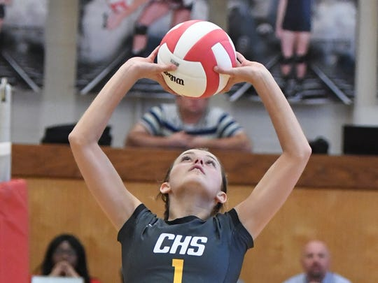 Camden's Jordan Vick sets the ball for a teammate during their game against South Side, Thursday, September 7. Camden defeated South Side, 3 sets to 0.