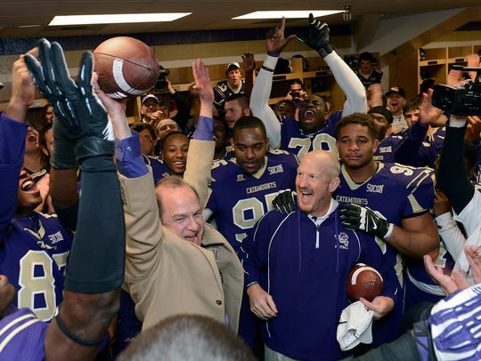 Western carolina Coach Mark Speir presents game ball