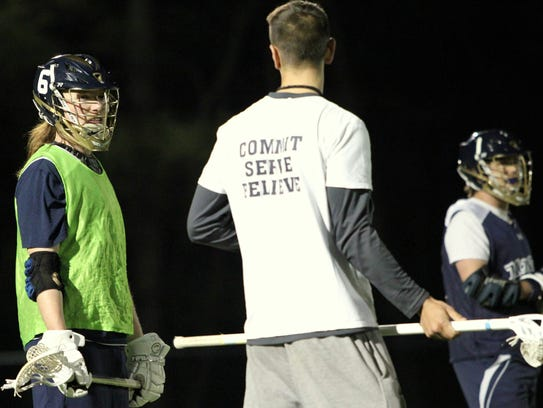 Assistant coach Ethan Kamholtz talks to a Cavaliers