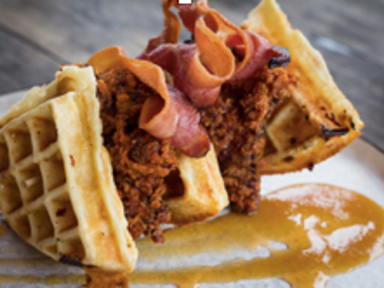 Chicken and waffles — with pork belly — with peach compote and spiced honey