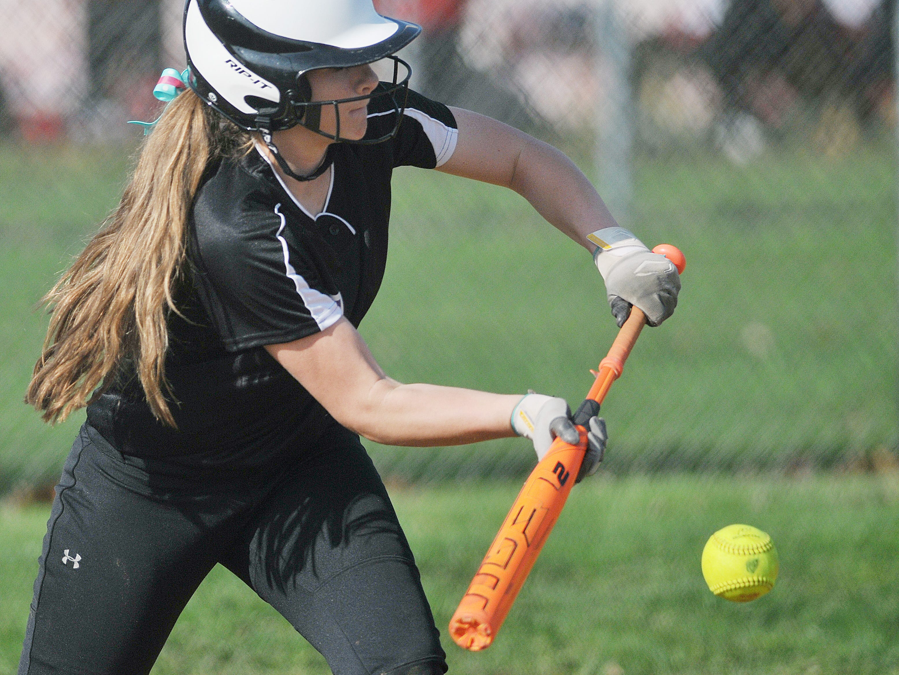 Lexington's Chelsie Alt attempts a bunt against Mount St. Dominic during the Wendy;s Spring Classic at Brookside Park West Field No. 2 Friday.