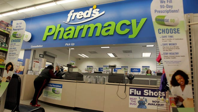"This Dec. 7, 2015 photo, shows discount retailer Fred's Pharmacy in Memphis, Tenn. Fred's, a small regional drugstore chain from Memphis, had a good week. It all started Tuesday, Dec. 20, 2016, when Fred's said it would pay $950 million to buy 865 stores that Rite Aid needs to sell in order to close a $9.4 billion buyout deal from Walgreens Boots Alliance Inc. The deal will more than double its current store count and Bloom called it a ""transformative event"" for the company. (Nikki Boertman/The Commercial Appeal via AP)"