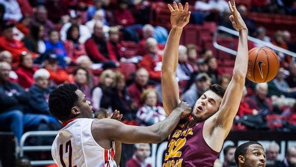 Ball State's Bo Calhoun knocks away a shot against Central Michigan during their game at Worthen Arena Saturday.