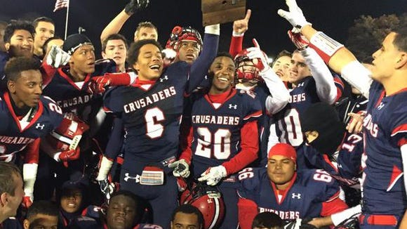 Stepinac's T.J. Morrison (6) hoists the championship