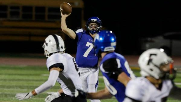 Oshkosh West High School's Ben Kohl throws the ball downfield against Fond du Lac.  Oshkosh West Wildcats played host to the Fond du Lac Cardinals at JJ Keller Field at Titan Stadium, September 28, 2017.