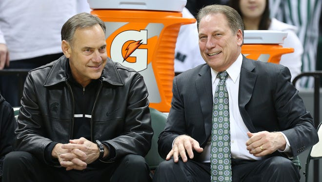 Michigan State Spartans football coach Mark Dantonio and Michigan State Spartans basketball head coach Tom Izzo talk prior to a game Jan. 25, 2014, at Jack Breslin Student Events Center.
