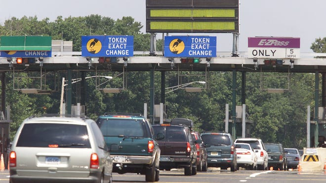 """Cars line up at a Garden State Parkway toll plaza in this 2011 file photo. Time is running out to speak out against """"toll lanes"""" on the Internet"""