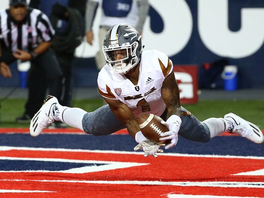 N'Keal Harry makes a touchdown catch against Arizona in the third quarter during the 2016 Territorial Cup in Tucson.