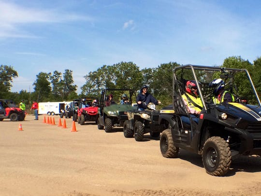 ATV riders await the signal to begin driving at the Dyracuse Recreational Park on Sept. 19.