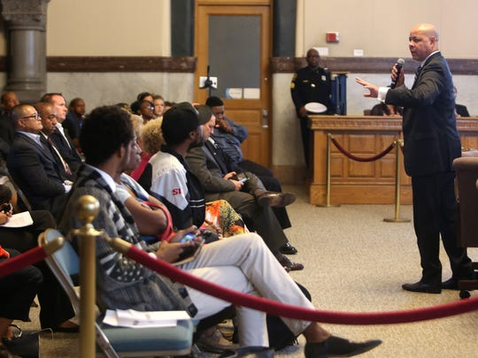 Cincinnati City Manager Harry Black addresses the crowd during a 2015 Cincinnati City Council meeting about Police Chief Jeffrey Blackwell being fired.