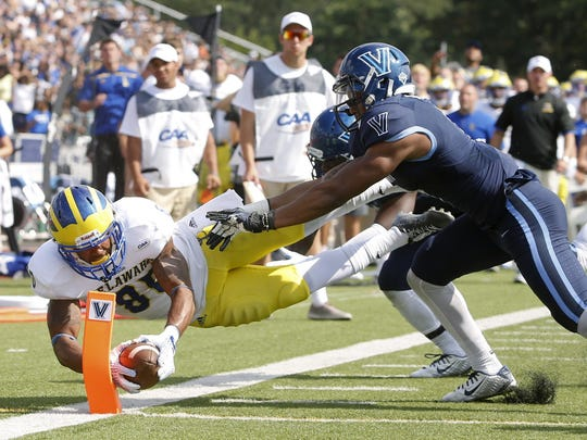 Delaware wide receiver Diante Cherry hits the pylon on a reverse on a successful two-point conversion attempt in the fourth quarter of the Blue Hens' 28-21 loss at Villanova Saturday. The score gave the Hens a 21-20 lead with 10:58 to play.