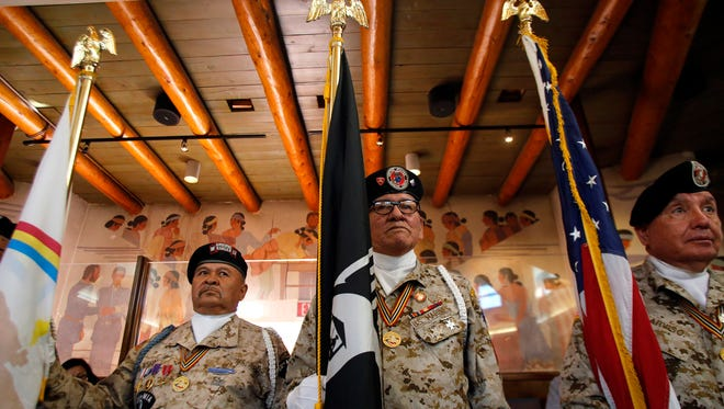 Members of the Tohatchi Veterans Organization Color Guard stand at attention Oct. 19, 2015, before the start of a Navajo Nation Council session at the Council Chambers in Window Rock, Ariz.