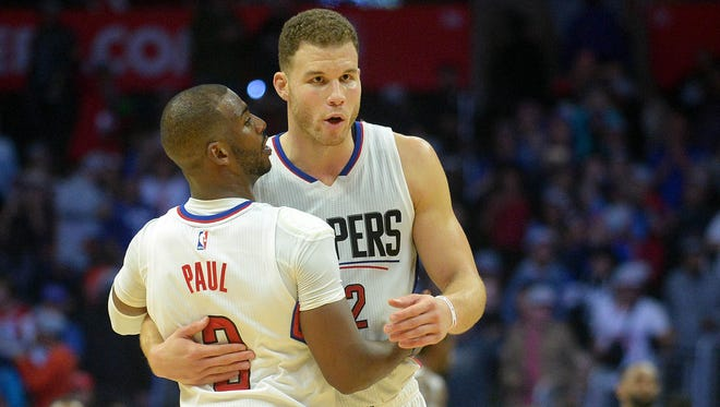 Los Angeles Clippers guard Chris Paul (3) and forward Blake Griffin (32) celebrate the 123-115 victory against the Toronto Raptors at Staples Center.