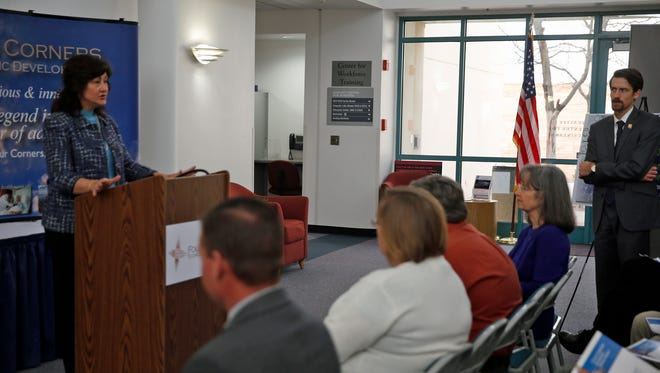 Mary Homan, economic development and community affairs manager for New Mexico Gas Co., speaks before presenting a check for $40,000 to Warren Unsicker, the new CEO of Four Corners Economic Development, on Wednesday at the Quality Center for Business at San Juan College in Farmington.