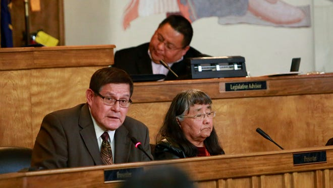 Speaker LoRenzo Bates, left, address the Navajo Nation Council on Jan. 26 in Window Rock, Ariz. Patty Chee, right, president of the Community Land Use Planning Committee at Tiis Tsoh Sikaad Chapter, helped Bates present his bill during the winter session last year.
