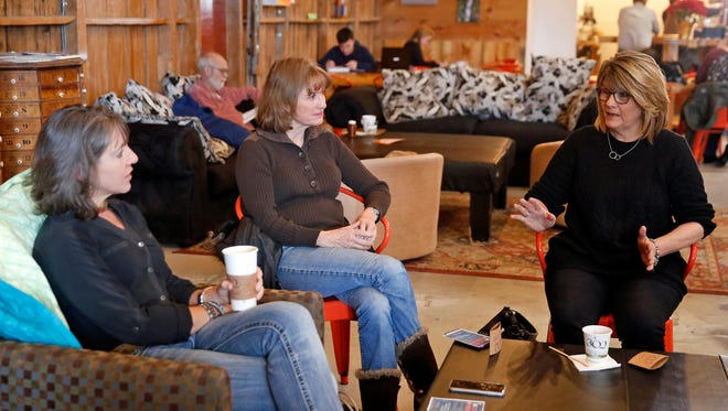 """Jamie Church, left, talks with Kathy Price and Melanie Rotert on Wednesday at 302 Espresso in Farmington during the """"Welcome to Farmington Coffee."""""""