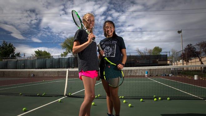 Farmington's Elise Ballard, left, and Emily Nguyen pose for a portrait on Wednesday at the Lions Park tennis courts in Farmington.