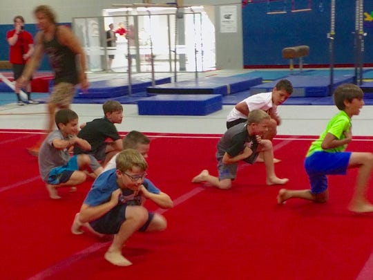 "Kids practice their chicken runs during a ""Ninja Clinic"""