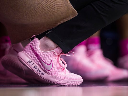 "Georgia Tech head coach MaChelle Joseph wears pink shoes with handwriting that read's ""My Mom"" along the sole as teams wear pink for breast cancer awareness during an NCAA college basketball game against Notre Dame, Sunday, Feb. 11, 2018, in South Bend, Ind. (AP Photo/Robert Franklin)"