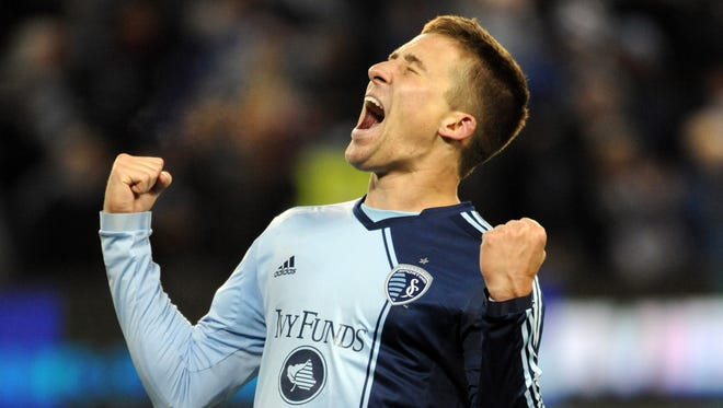 Sporting KC defender Matt Besler (5) celebrates after the MLS Eastern Conference Championship soccer game against the Houston Dynamo at Sporting Park. Sporting KC won 2-1.