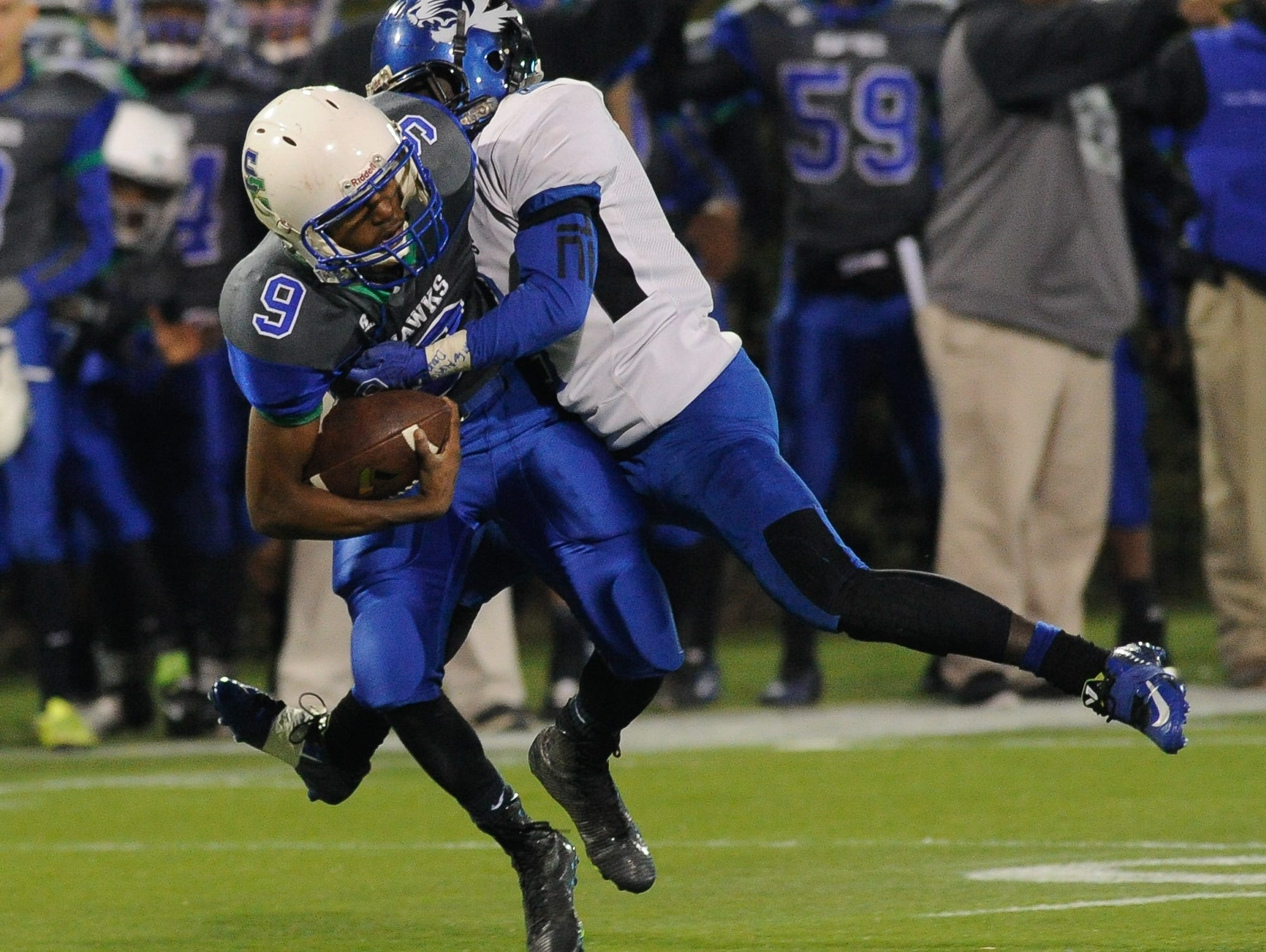 Howard's #2 Na'Quan Watson tackles St. George's quarterback #9 Tordell Kemp during the Division II championship.
