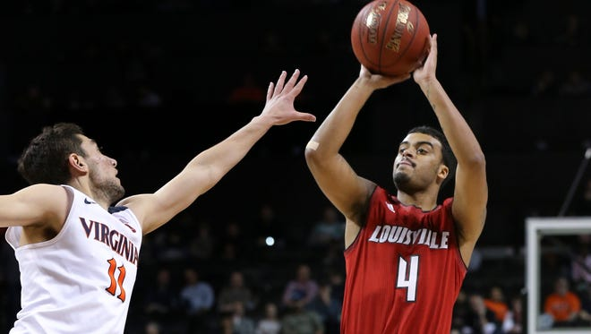 U of L's Quentin Snider (4) shot against Virginia's Ty Jerome (11) during the ACC Tournament in Brooklyn, NY.    