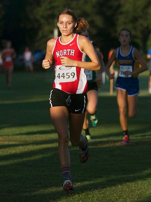 North Fort Myers High School's Kayla Easterly races in the Hoptar Invitational at Veterans Park in Lehigh Acres on Saturday. Easterly finished third.