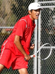 Sanjay Garimella with a serve as he and Benny Zhang