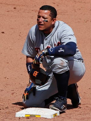 Tigers' Miguel Cabrera kneels at second while he waits for a pinch runner in the ninth inning against the Pirates in Pittsburgh, April 26, 2018.