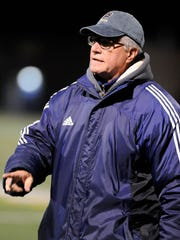 Pocomoke head coach Alan Byrd talks to his team before a Class 1A  boys soccer state semifinal against McDonough Friday, Nov. 7, 2014 in Pasadena. (Photo by Steve Ruark for The Daily Times)