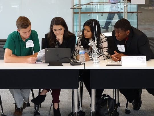 Students compete in the Junior Achievement Titan Challenge in Greenville on April 22, 2016.