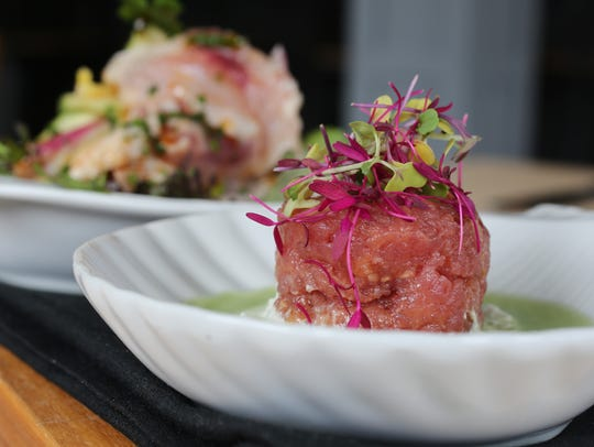 The Yellowfin Tuna Tartare, front, and Day Boat Ceviche,