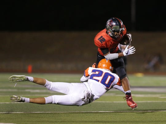 Canutillo defensive back Nathan Martinez makes a diving tackle on Hanks wide receiver Nick Frayre Friday night at Hanks High School.