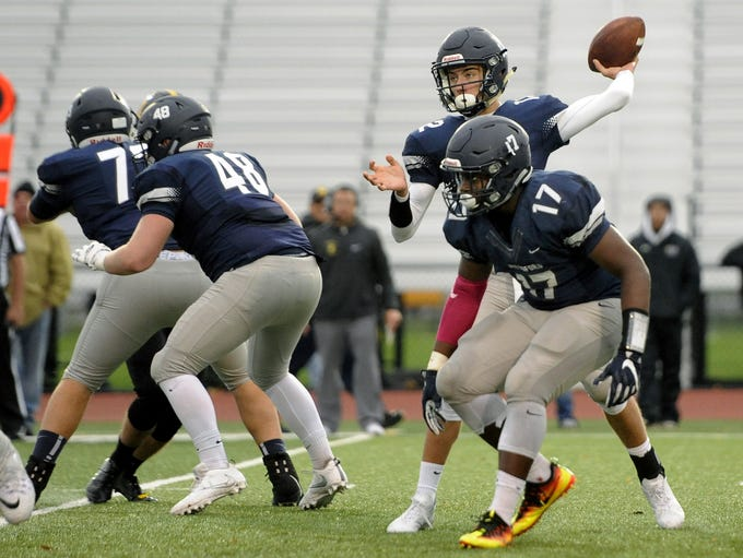 Pittsford's Matt Larocca throws a pass from the pocket