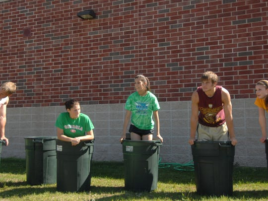 Ross Jirgl, second from right, is shown in a 2007 photo as a 17-year-old Wausau East High School track athlete icing his legs.